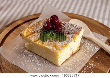 appetizing cottage cheese casserole piece on wooden ditch