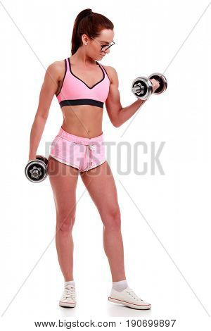 Clever girl in glasses with dumbbells, isolated on clear white background