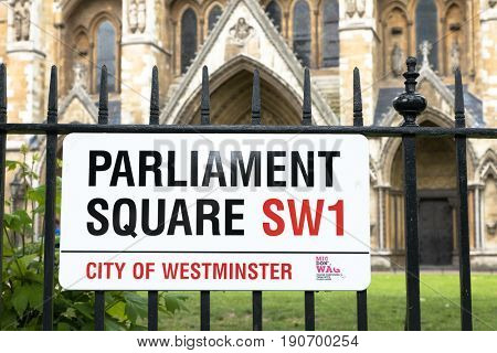 London, UK - 5 June 2017: Close-up of the City of Westminster Street Sign for Parliament square, with Westminster Abbey in the background.