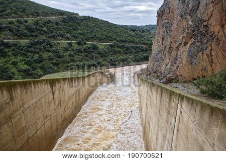 Reservoir Jándula expelling water after several months of rain Jaen Spain