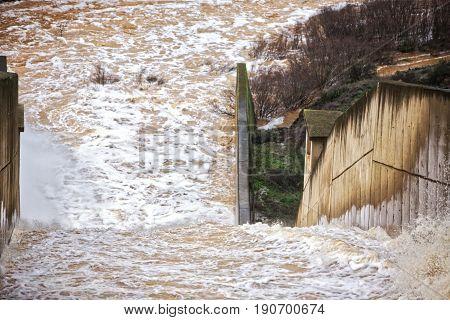 Reservoir Jándula expelling water after several months of rain Jaen Spain