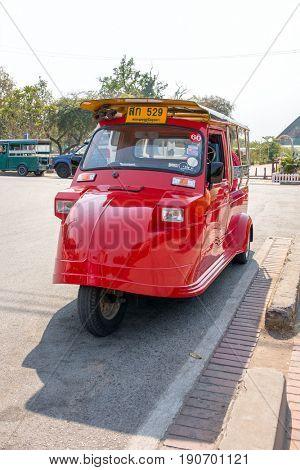 Ayutthaya, Thailand - March 2, 2017: Vintage Tuk Tuk taxi in Ayutthaya historical park. A traditional three wheel taxi car in Ayutthaya, Thailand