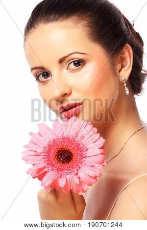 Woman with pink gerber flower over white background