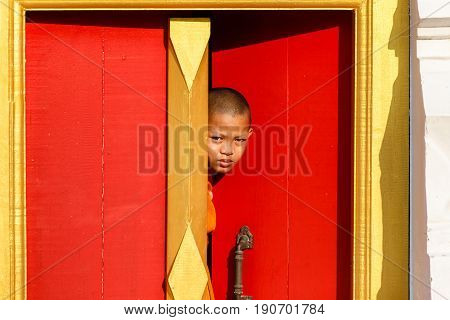 Young Novice monk smile in monastery the big window temple at Ayutthaya historical park in Thailand