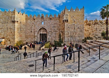 JERUSALEM, ISRAEL - DECEMBER 29, 2016: Damascus gate, nord entrance in old part of Jerusalem. Gate was built in 1537 by Suleiman the Magnificent with repairs to the turrets made in 2011 by Israel.