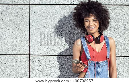 Girl With Afro Using Mobile Phone.