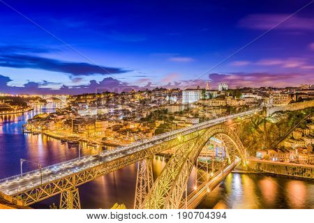 Porto, Portugal Skyline over Dom Luis I Bridge and Douro River.