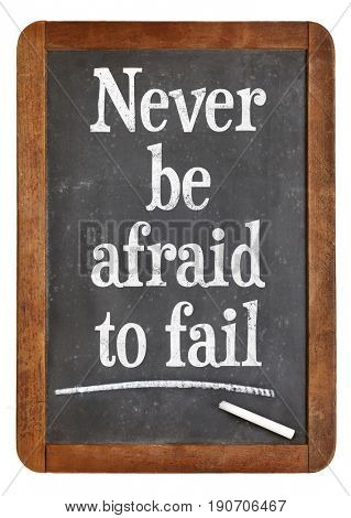 Never be afraid to fail - white chalk text on a vintage slate blackboard