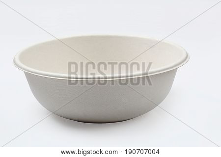 Biodegradable bowl isolated on white background with clipping path Unbleached plant fiber for food.