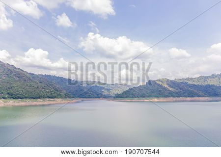Landscape of natural dam mountain and water reservoir under cloudy sky natural irrigation system.