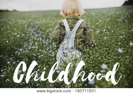 Childhood word on young boy outdoors