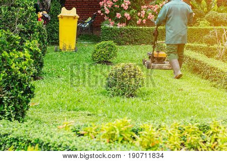 People are cutting grass in the garden.