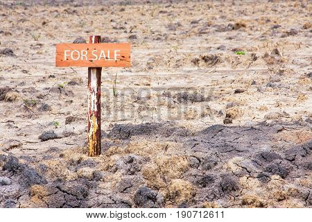 reclamation land area with wooden sign pole for sale
