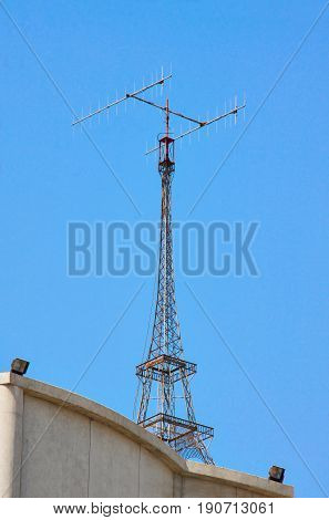 TV antenna Eiffel tower style on building