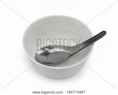 old plastic empty bowl with spoon on white background