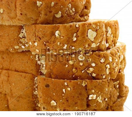 Closeup of Fresh sliced wholewheat bread with various seeds and multigrain on white background