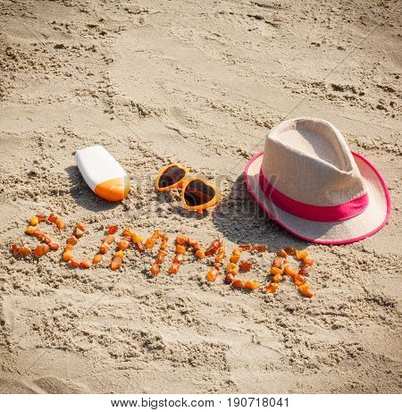 Word Summer, Sunglasses, Sun Lotion And Straw Hat On Sand, Concept Of Summer Time