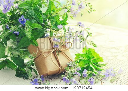 Bouquet of small delicate blue flowers veronica gift box on table closeup