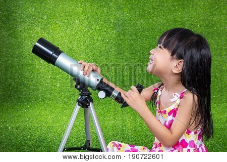 Asian Chinese Little Girl Playing With A Telescope