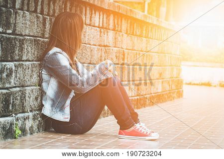 Lovely lady sitting alone .lonely lovelorn women .Style loneliness divorce stressed. Light Fair