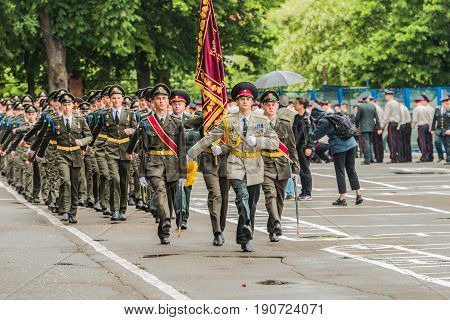 KYIV, UKRAINE - May 26, 2017: Students of the Kiev military lyceum of Ivan Bohun take part in the celebrations dedicated to the end of the academic year. Removal of the lyceum's banner.