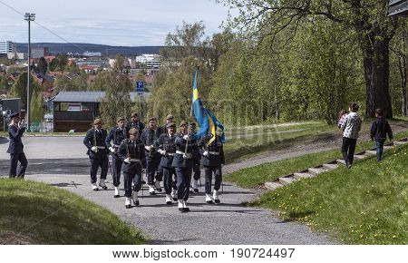 UMEA, SWEDEN ON JUNE 06. View of the Swedish Home Guard, National Security Forces on June 06, 2017 in Umea, Sweden. Music and parade to the venue. Unidentified people in action. Editorial use.