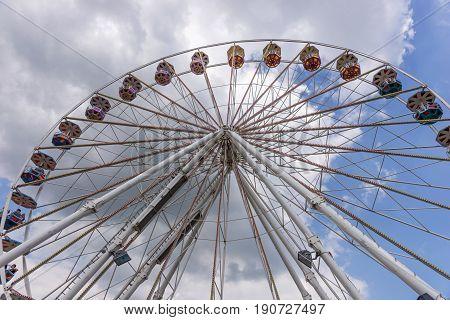 Big ferris wheel on the cloudy sky