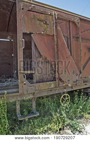 Old railway wagon on siding and waiting to cassation or repair.