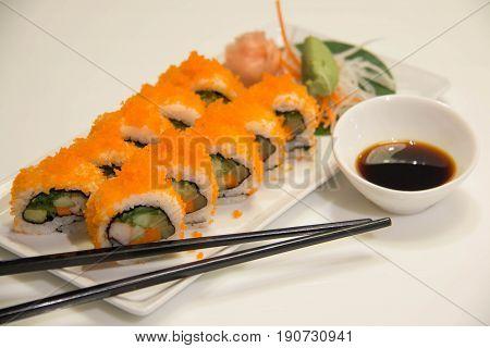 Egg imitation crabmeat cucumber roll sushi and chopsticks