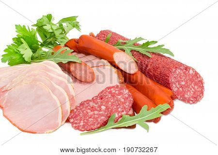 Sliced boiled smoked pork loin and ham partly sliced salami and hunting sausages with arugula and parsley closeup on a light background