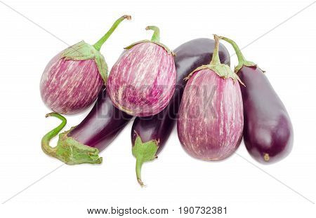 Pile of the conventional purple eggplants and Graffiti eggplants on a light background