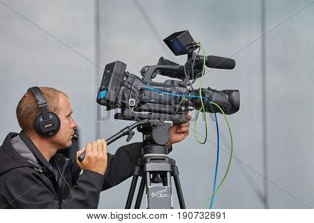 HODONIN, CZECH REPUBLIC - AUGUST 17, 2014: Cameraman recording the stage during the concerts of Made of Metal festival.