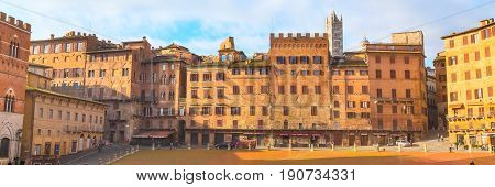 Siena, Italy - November 16, 2014: Panoramic image of houses at Piazza del Combo square at Siena, Tuscany, Italy