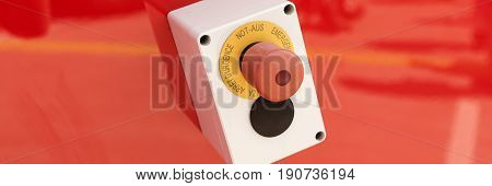 Emergency button on red background, german Not-Aus