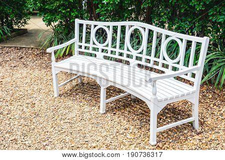 white bench in the garden clean new