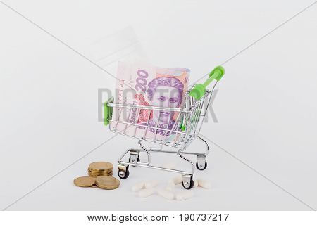 Two hundred hryvnias in the shopping pushcart on the light background