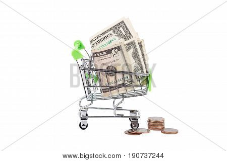 American dollars in the shopping pushcart isolated on white