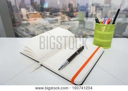 mock up notepad with pen for taking note