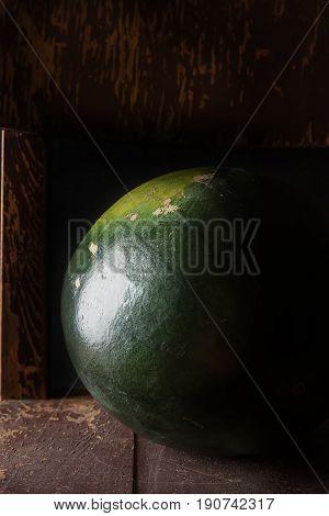 Watermelon Whole. Dark Wood Background. Autumn Photos.