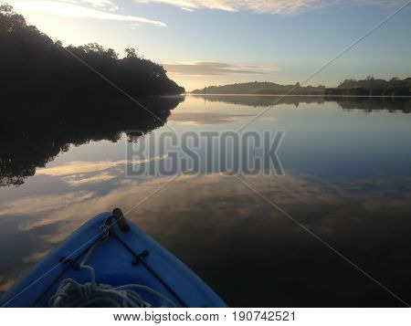 Kayaking on the Kerikeri Inlet New Zealand NZ at dawn on a winter morning with sea mist