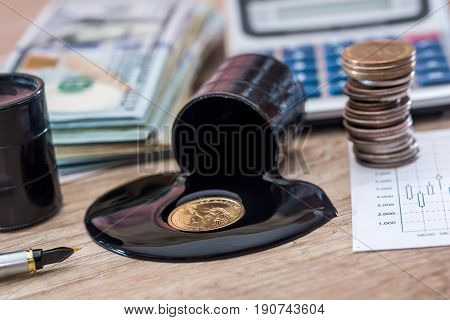 Dollars Banknote With Spilled Oil On Desk. Calculator With Oil Production Schedule. Business Concept