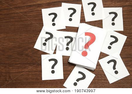 Big question mark on a piece of paper. Many question marks on paper. Question concept.