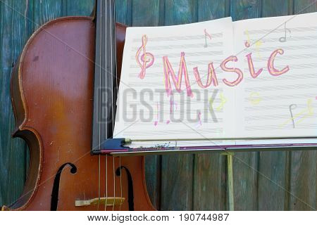 Music stand with note sheets and written word Music outdoor cropped image concept of live performance