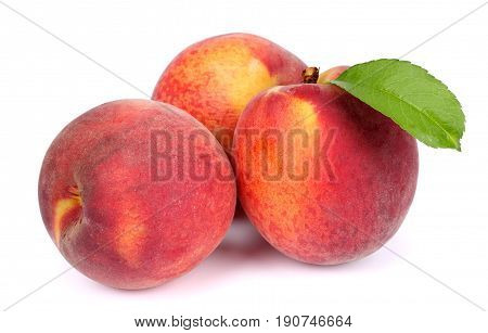 Peach. Fruit with green leaf isolated on white background