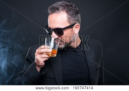 Handsome Millionaire Enjoying A Glass Of Whiskey