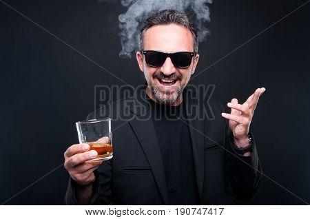 Stylish Rich Bearded Man Enjoying A Brandy