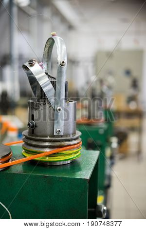 Mechanism for making metal braiding. Abstract industrial background.