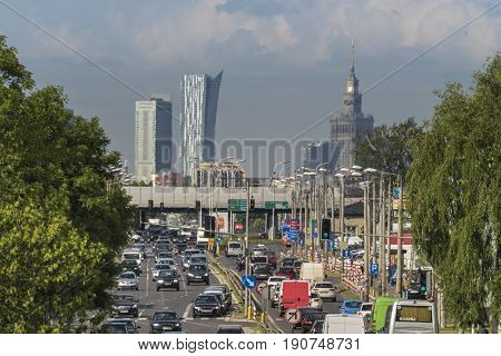 Hot air over access road to Warsaw city with downtown panorama of the city.