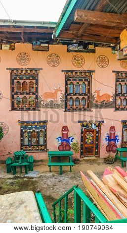 Bhutanese house with traditional phallus paintings near Punakha Bhutan. Symbol brings good luck and drives away evil spirits.