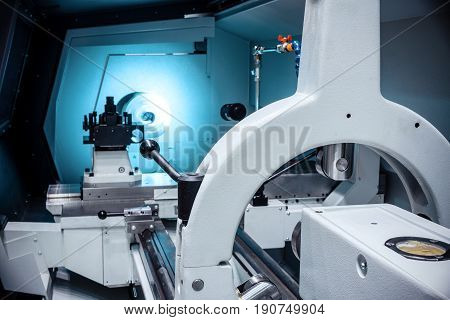 Working area of modern lathe metalworking CNC machine. Tinted in neutral industrial colors.